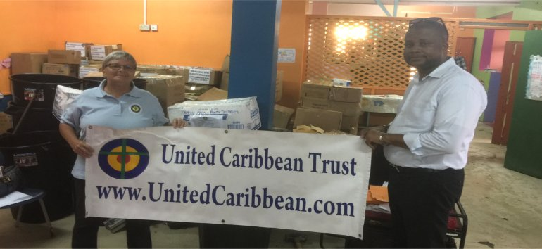 Jenny Tryhane founder of United Caribbean Trust partnering with The Living Room distributing Sawyer PointOne Water Filtration Systems in Dominica following hurricane Maria